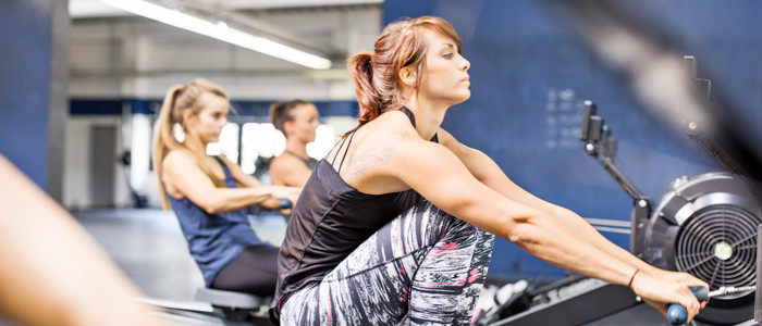 woamn rowing in gym