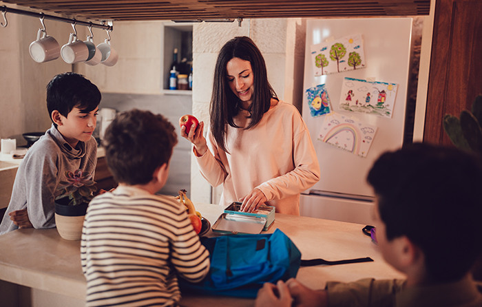 mother packing lunch for kids