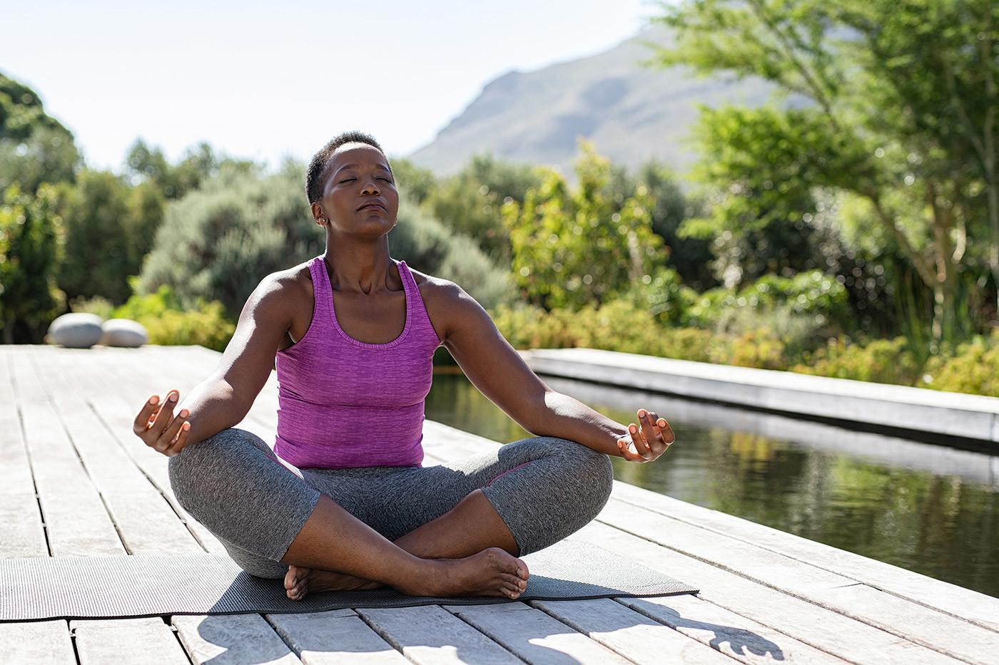 woman meditating outdoors