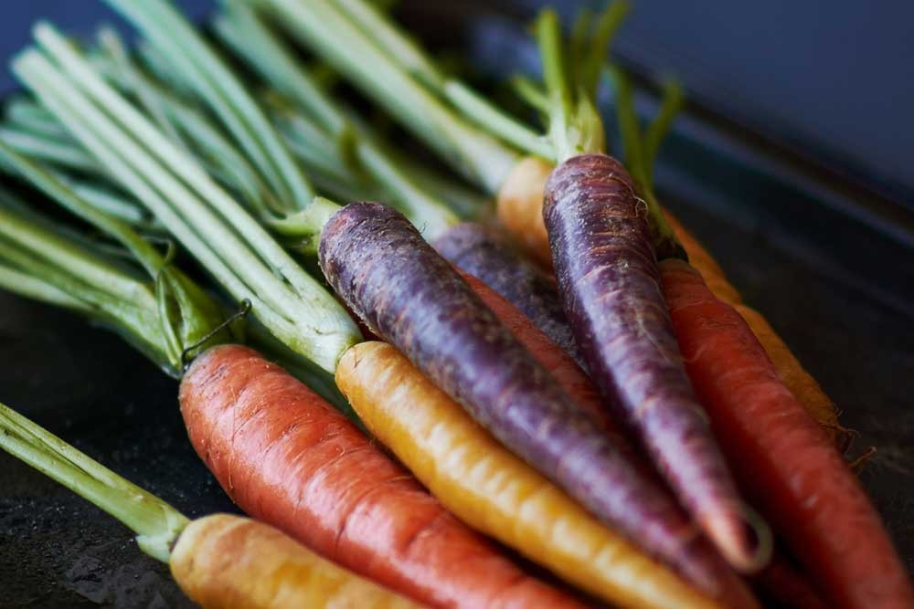 Close up of orange and purple carrots