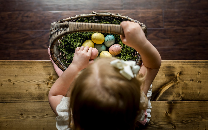 girl making an easter basket