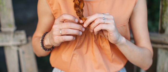 woman braiding her hair