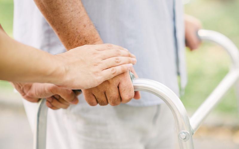 hands holding a walker