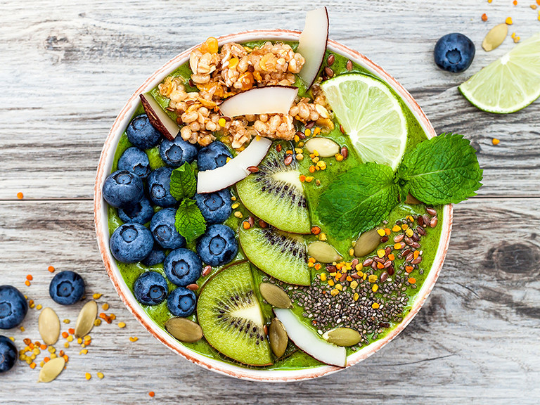bowl of acai with kiwi and cereal