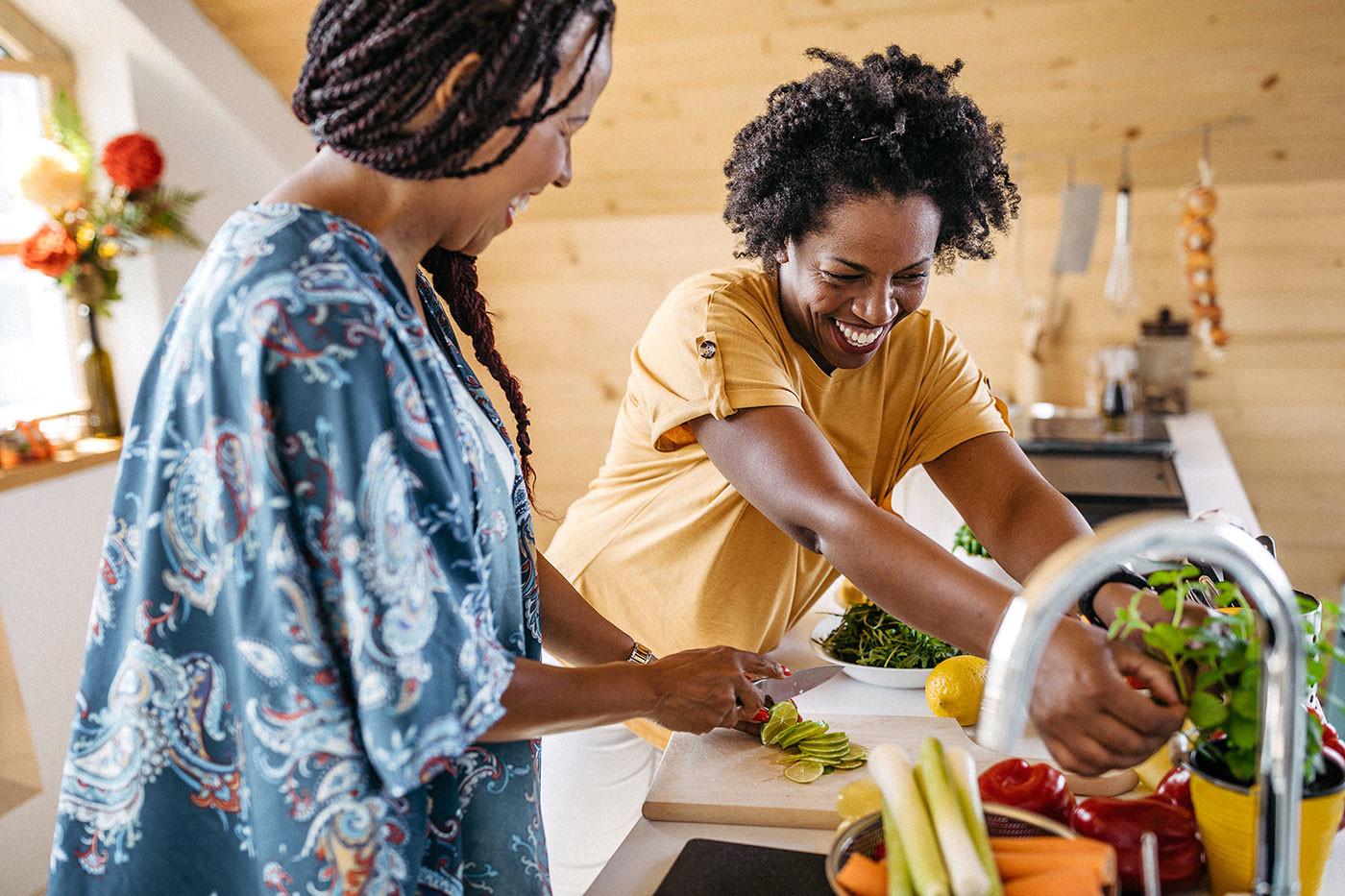 two women washing vegetables