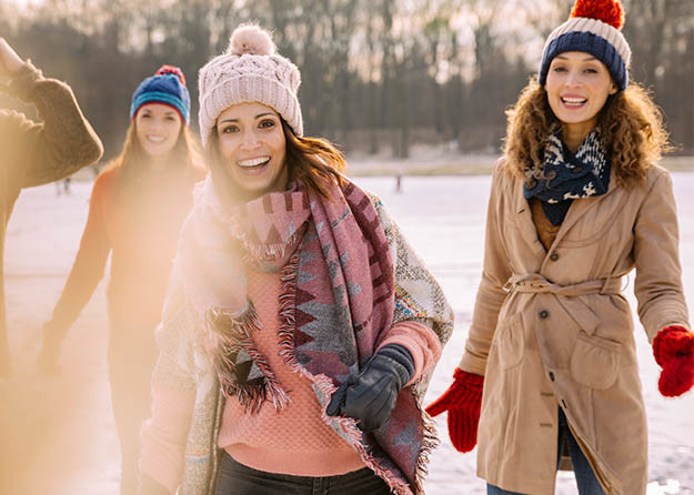 women playing in snow