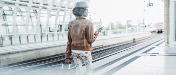 woman walking on a train platform