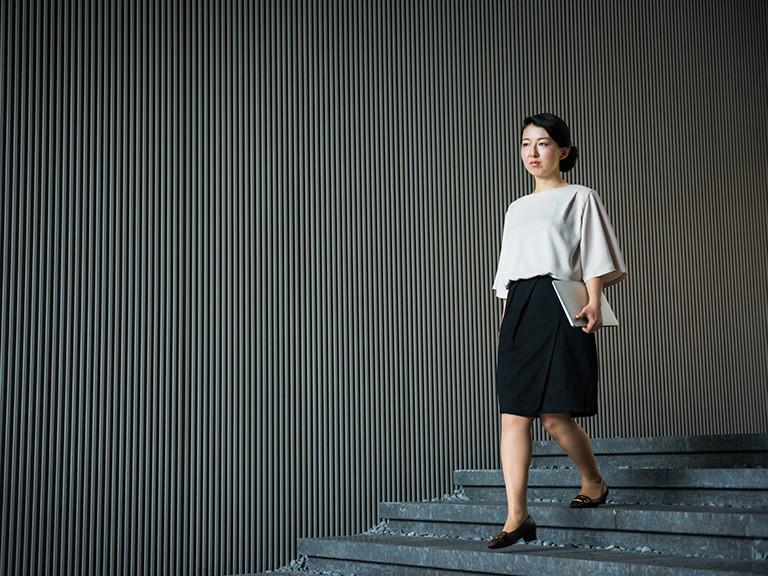woman walking down stairs