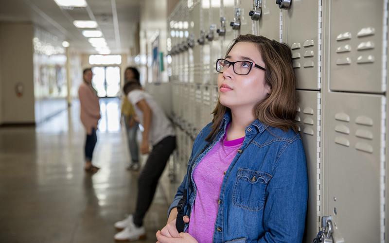 Girl next to locker