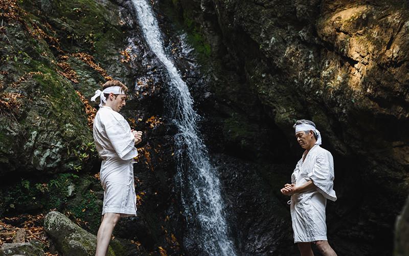Men near a waterfall