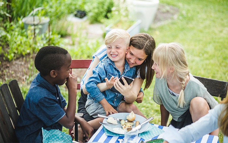 Kids eating at a table outdoors